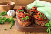 Appetizer- bruschetta with olive oil, sun-dried tomatoes and parsley — Stock Photo