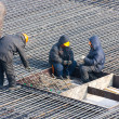 Builders prepare rebar for the foundation of building — Stock Photo