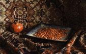 Still life of Armenian pomegranate and carpet — Stock Photo
