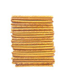 Salted sticks arranged horizontally isolated on white background — Stock Photo