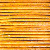Salted sticks arranged horizontally — Stock Photo