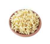 Wide egg noodles in bowl of clay isolated on white. — Stock Photo