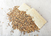 Ground wheat and hemp with Crisp bread from corn grits over bagging. — Stock Photo