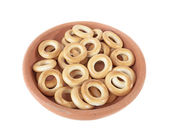 Bagels in a bowl of clay isolated over white — Stock Photo