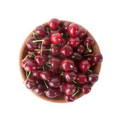 Red cherries in clay bowl isolated on white background — Foto de Stock