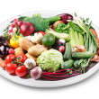 Lots of vegetables on a plate. - Stock Photo