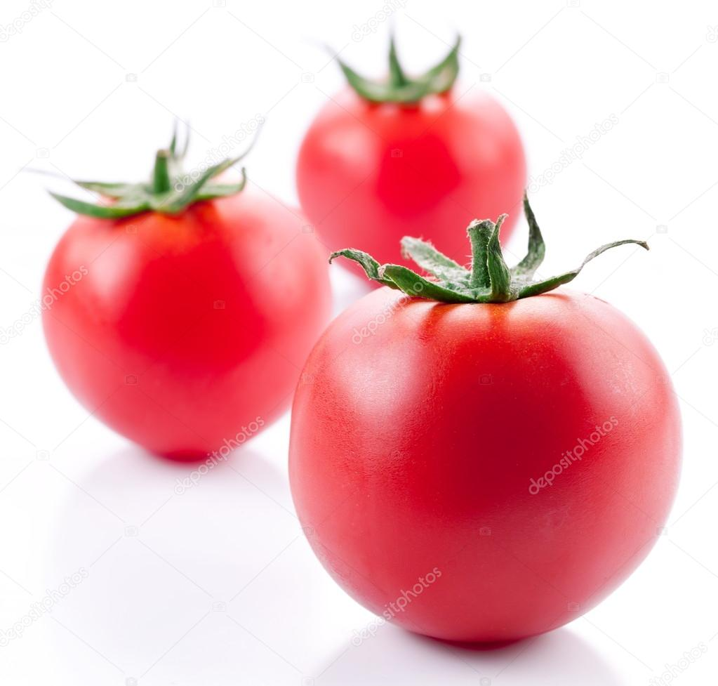 Tomatoes on a white background — Stock Photo #12037175