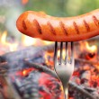 Sausage on a fork. - Stock Photo