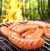 Sausages on a grill. — Photo