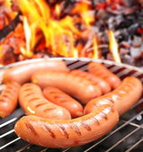 Sausages on a grill. — 图库照片