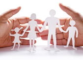 Cardboard figures of the family on a white background. — Stok fotoğraf