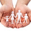 Cardboard figures of the family on a white background. — Stock Photo