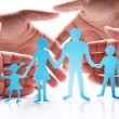Cardboard figures of the family on a white background. - Stock Photo