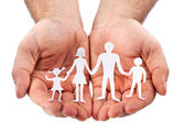 Cardboard figures of the family on a white background. — Foto Stock