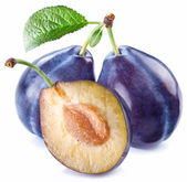 Plums with a slice and leaf — Stock Photo