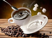 Falling cup coffee — Stock Photo