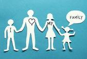 Chiffres en carton de la famille sur un fond bleu. — Photo