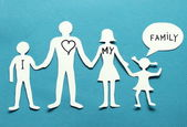 Cardboard figures of the family on a blue background. — Stock Photo