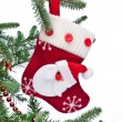 Royalty-Free Stock Photo: Christmas sock with Santa Claus on on fir branch.