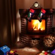 Christmas gifts by the fireplace. - Stockfoto