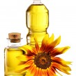 Cooking oil in a plastic and glass bottles with sunflower. — Stock Photo #13376636