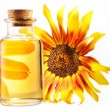 Cooking oil in glass bottle with sunflower on a white background — Stock Photo
