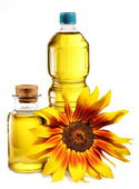Cooking oil in a plastic and glass bottles with sunflower. — Stock Photo