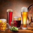 Beer barrel and draft beer by the glass. - Stock Photo