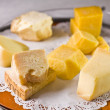 Variety of cheeses on a lace napkin. - Stock Photo