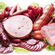 Meat and sausages on lettuce leaves. — Stock Photo #13740823