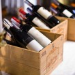 Wine bottles in wooden boxes. - Stock Photo