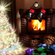Christmas gifts by the fireplace. - Stock Photo