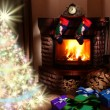 Christmas gifts by the fireplace. - Zdjęcie stockowe