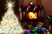 Christmas gifts by the fireplace. — Stock Photo