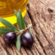 Ripe black olives with leaves. - Stock Photo
