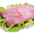 Raw meat on lettuce leaves. - Foto Stock