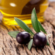 Ripe black olives with leaves. — Stock Photo