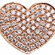 Heart in the form of diamonds on a gold surface. - Stock Photo