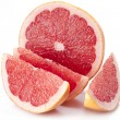 Grapefruit with slices. - Zdjęcie stockowe