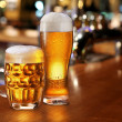 Glass of light beer. - Stock Photo