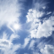 Blue sky with clouds and sun. — Stock Photo #16225215