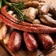 Assortment of grilled sausages. - Stock Photo