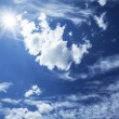 Blue sky with clouds and sun. — Stock Photo #16225525