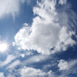 Blue sky with clouds and sun. — Stock Photo