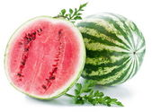 Watermelon with a slice and leaves — Stock Photo