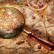 Magnifying glass on old map. — 图库照片