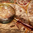 Magnifying glass on old map. — Stok fotoğraf