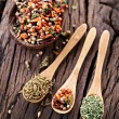 Variety of spices in the spoons. - Stock Photo