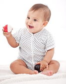 Happy 7-monthes baby girl playing with balls. — Stock Photo