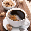 Cup of coffee with brown sugar. — Stock Photo #20398677
